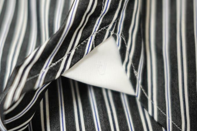 UNIQLO+J2021SS_スーピマコットンオーバーサイズスタンドカラーシャツ_裾(ホワイト+ロゴ)